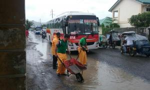 Traffic Management Bureau (TMB) Personnel Filled up the Potholes along the National Highway from Barangay Mangan-Vaca to Barangay Ilwas